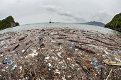A remote island in Indonesia has become littered with plastic and other garbage brought by oceanic currents that swirl through the archipelago. Floating garbage is a major pollution problem throughout