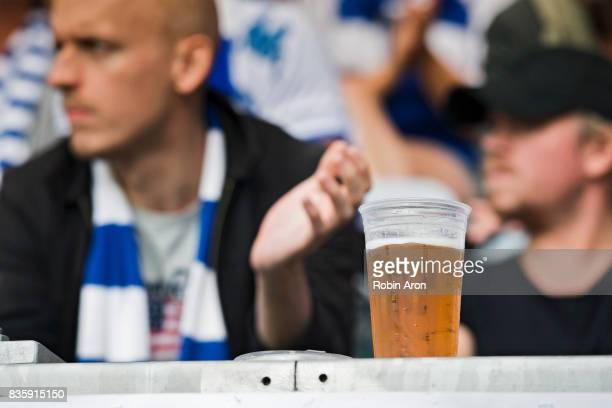 A plastic glass with beer during the Allsvenskan match between IFK Goteborg and BK Hacken at Gamla Ullevi on August 20 2017 in Gothenburg Sweden