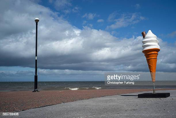 A plastic ice cream cone lures holidaymakers to a cafe on the promenade of Rhyl seaside resort on August 3 2016 in Rhyl Wales British seaside resorts...