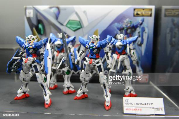 Plastic models of Gundam Exia are displayed at a booth at Tokyo Big Sight East Exhibition Halls during the AnimeJapan 2014 convention in Tokyo Japan...
