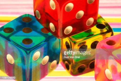 Plastic multi-colored dice : Stock Photo
