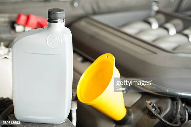 Plastic oil bottle on car