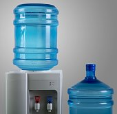 Water Dispenser with Two Big Water Bottles on the Grey Background