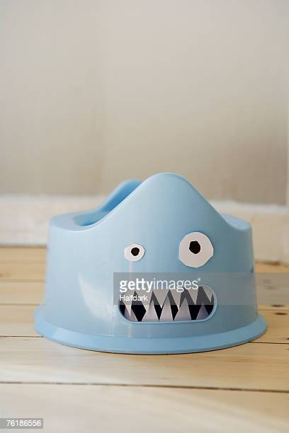 A plastic potty with a cardboard face
