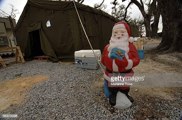 A plastic Santa sits outside the Secret Santa Shop where children can get gifts for their loved ones on December 2 2005 in Pass Christian Mississippi...