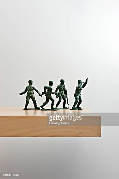 Plastic soldiers on table top