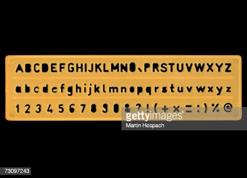 Plastic stencil of letters, numbers and symbols