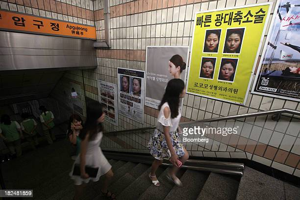 Plastic surgery advertisements are displayed along a staircase at the entrance of a subway station in the Apgujeongdong area of Gangnam district in...