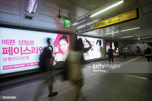 Plastic surgery advertisements are displayed in a subway station in the Apgujeongdong area of Gangnam district in Seoul South Korea on Saturday Aug 3...