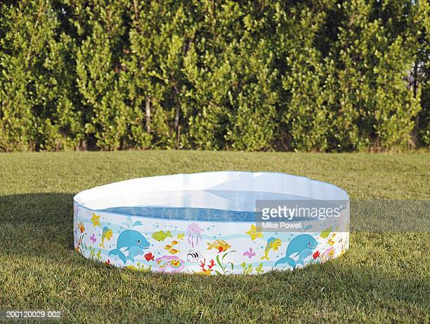 Plastic swimming pool filled with water