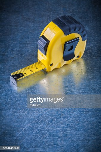 Plastic tape line on scratched vintage metallic background const : Stock Photo