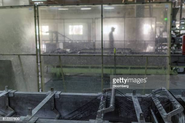 Plastic threads pass through an extruder that makes pellets at Dainichi Color India Pvt's factory in the Rajasthan State Industrial Development and...