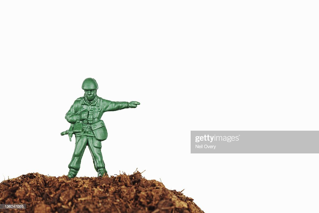 Plastic Toy Soldier Pointing the Way : Stock Photo
