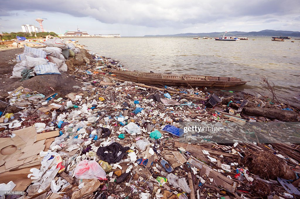 Plastic trash pollution on beach : Stock Photo