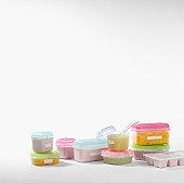 Plastic tubs containing food, studio shot
