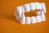 Plastic vampire teeth, close-up