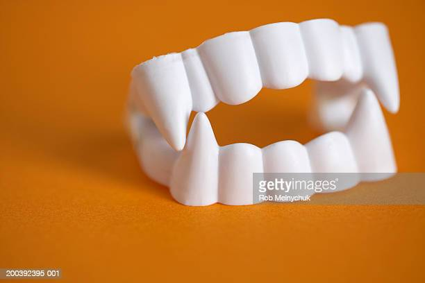 Plastic vampire teeth, close-up