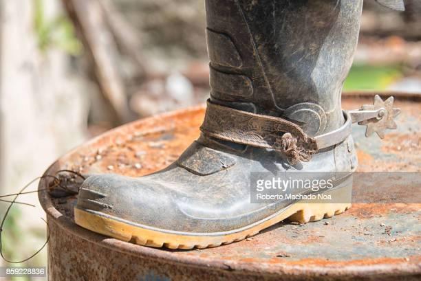 A plastic water boot with a spur It is worn by a local cowboy in the Hanabanilla area The image was taken while the person fixes the roof of a hut