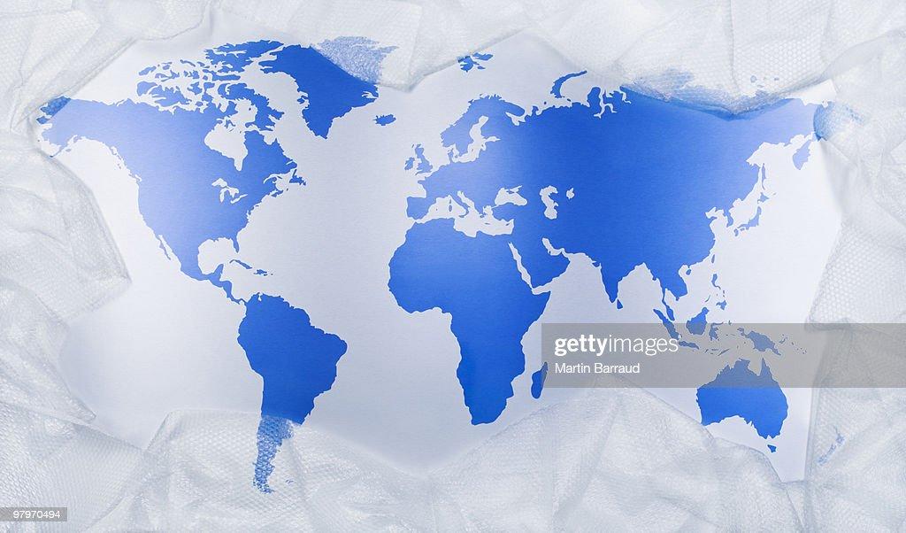 Plastic wrap around world map