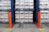 Plastic wrapped palettes holding containers of RoundUp a herbicide produced by Nufarm Ltd await transportation in the company's warehouse in Laverton...