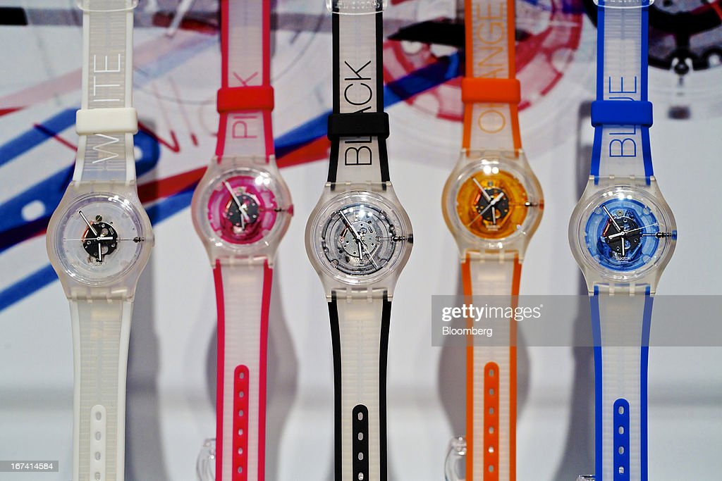 SUJK1 plastic wristwatches manufactured by Swatch Group AG sit on display at the company's booth during the Baselworld watch fair in Basel, Switzerland, on Wednesday, April 24, 2013. The annual fair attracts 2,000 companies from the watch, jewelry and gem industries to show their new wares to more than 100,000 visitors. Photographer: Gianluca Colla/Bloomberg via Getty Images