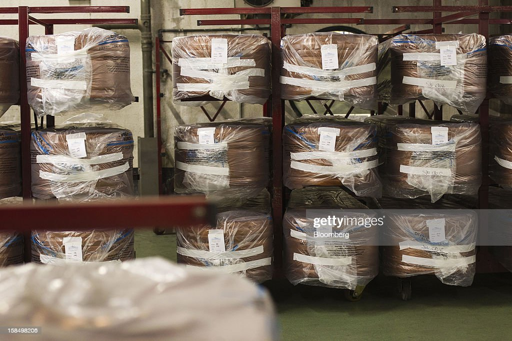 Plastic-wrapped coffins sit on racks inside the storage warehouse of the Empresa Mixta de Servicios Funerarios de Madrid SA funeral parlour in Madrid, Spain, on Monday, Dec. 17, 2012. Spain, responding to street protests and reports of suicides linked to foreclosures, introduced rules to help protect families from eviction, increasing the risk of creditor losses and weakening an already fragile banking system. Photographer: Angel Navarrete/Bloomberg via Getty Images