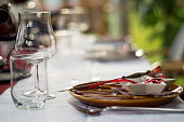 Plate, cutlery, glasses and more decoration items in festive red and white christmas decoration style