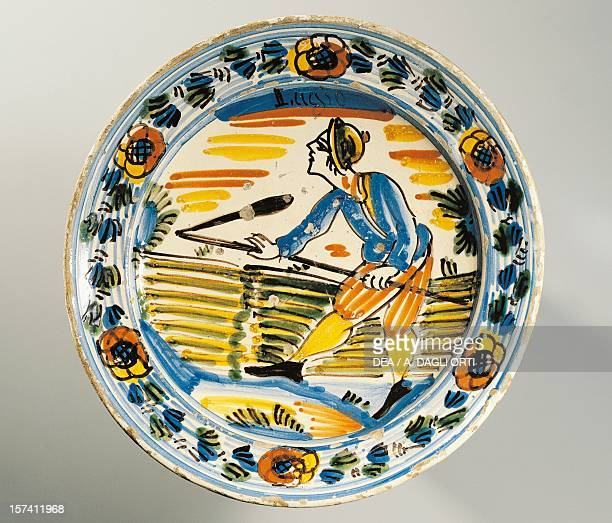 Plate decorated with the threshing of wheat symbol of the month of July piece taken from the Months series maiolica Bassano del Grappa manufacture...