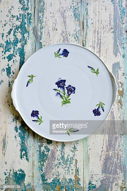 Plate, floral design, gentian, on wood