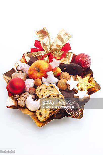 Plate full of cookies, fruits and gifts, close-up
