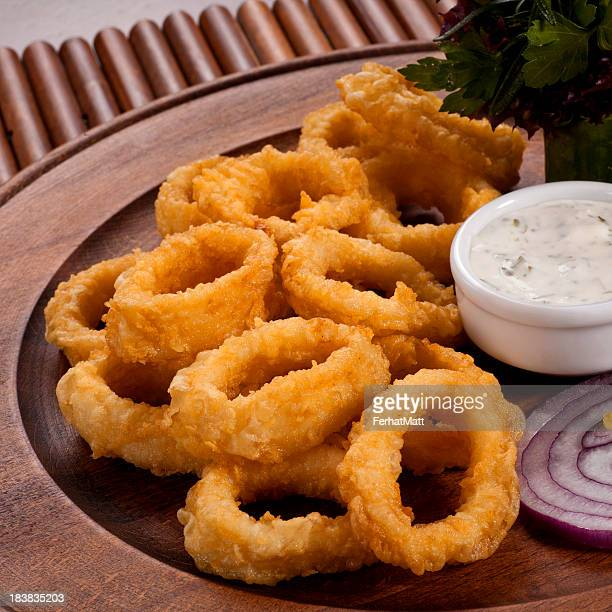 Plate full of fried calamari with dip