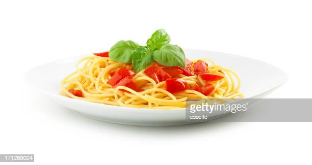 Plate full of spaghetti pasta with tomatoes