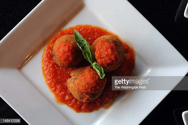 A plate of Arancini fried rice balls with tomato sauce at Dolce Veloce Cicchetti Wine Bar in Fairfax VA on March 8 2012