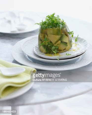 Plate of avocado jelly with micro herbs : Stock Photo