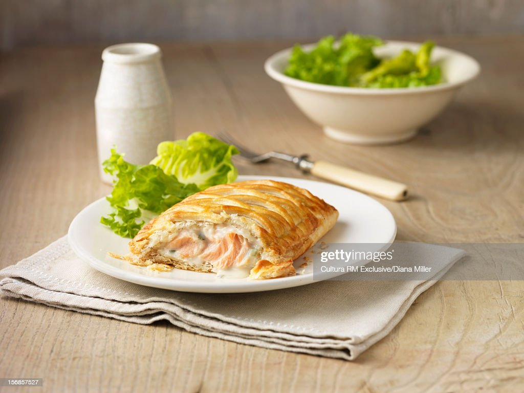 Plate of baked fish in pastry : Stock Photo