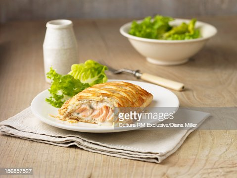 Plate of baked fish in pastry