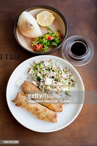 Plate of baked pastries with rice : Stock Photo