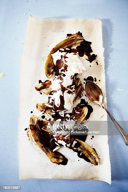 Plate of banana split with ice cream