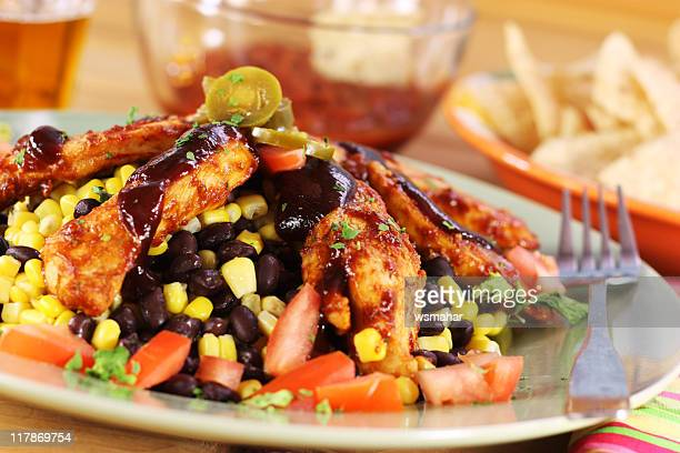 A plate of barbecue chicken mixed with vegetables