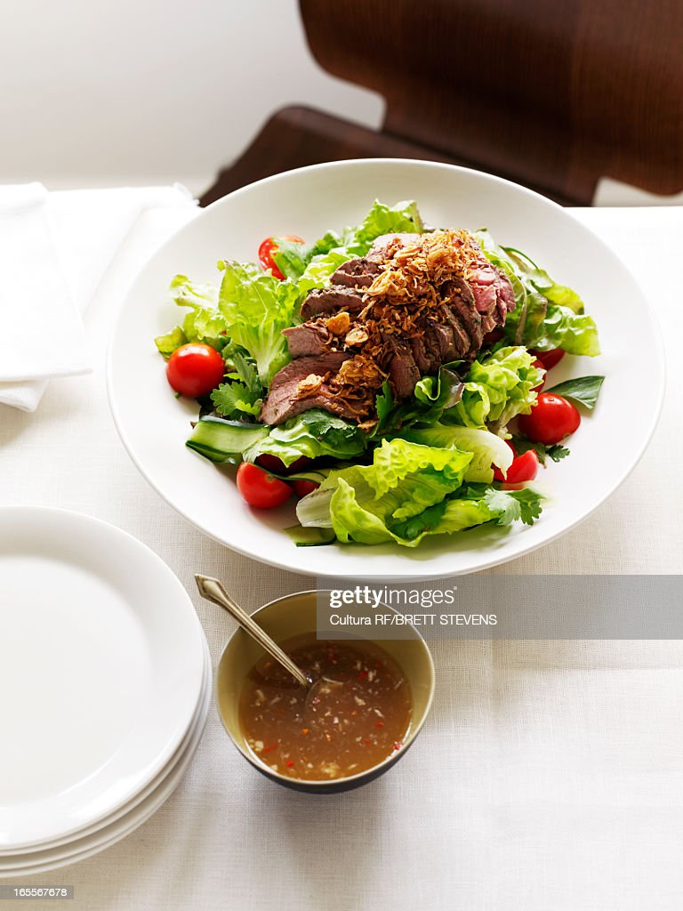 Plate of beef salad with sauce : Stock Photo