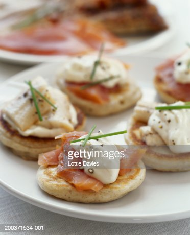 Plate of blinis with smoked salmon and sour cream, close-up : Stock Photo