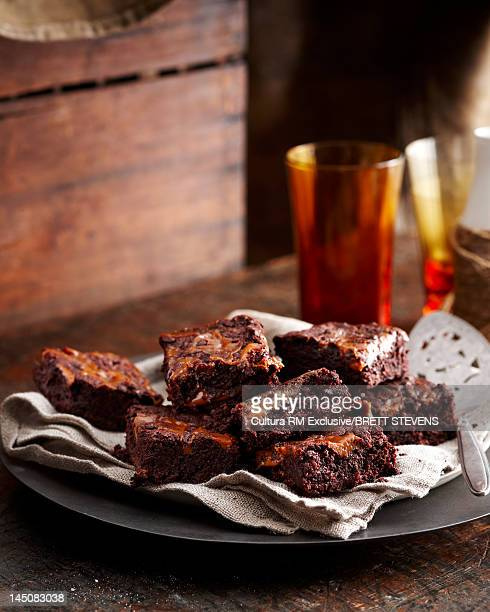 Plate of brownies on table