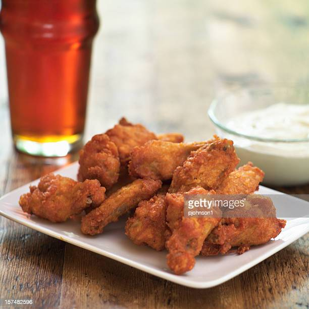 A plate of buffalo hot wings and a dip