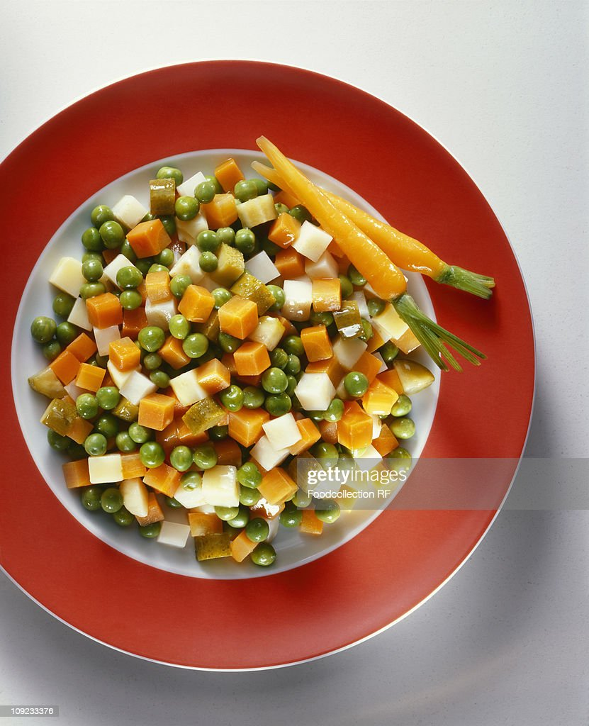 Plate of buttered vegetables, close-up : Stock Photo