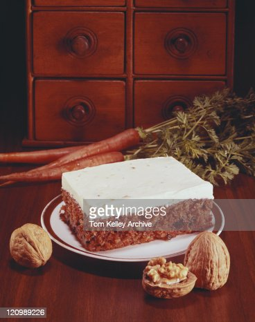 Plate of cake with walnuts beside, close-up : Stock Photo