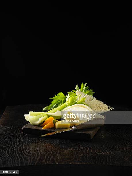 Plate of celery, orange, and cabbage