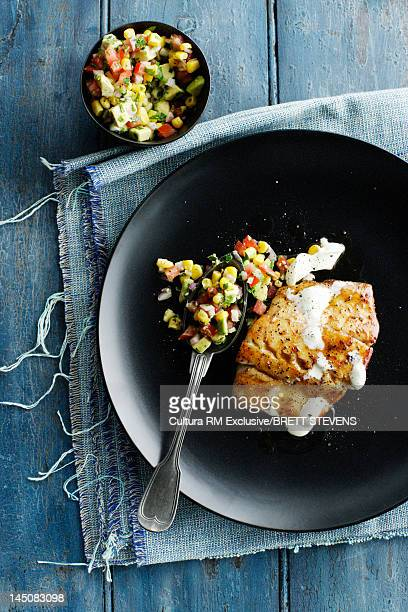 Plate of chicken and corn salsa