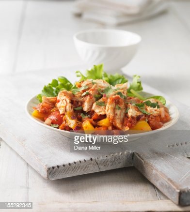 Plate of chicken with pepper salsa