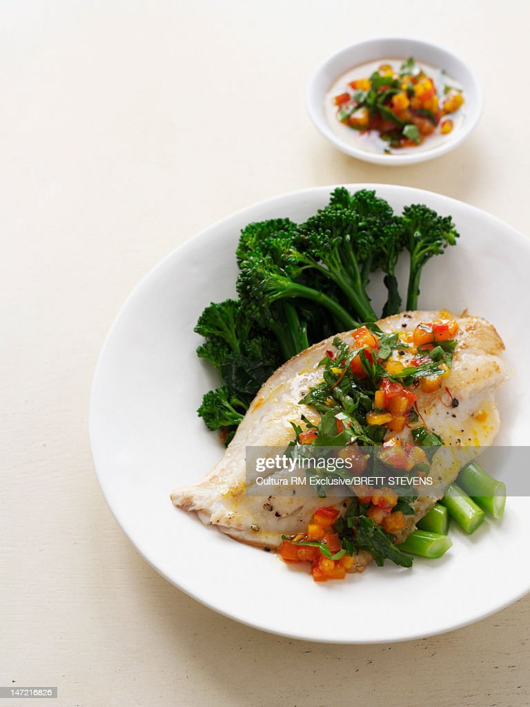 Plate of chicken with salsa : Stock Photo