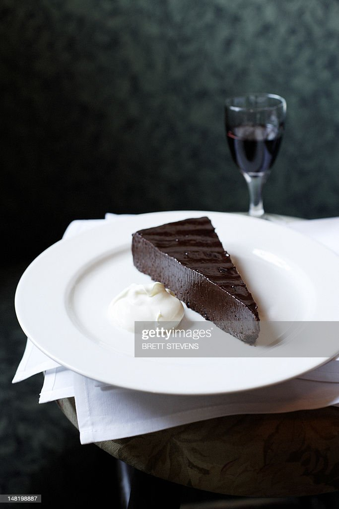 Plate of chocolate cake with whip cream : Stock Photo